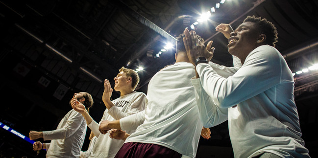 The University of Montana freshmen bench cheers their teammate's three point shot during the second half of the loss to the University of Michigan. Montana fell 74-55, and were knocked out of the tournament.