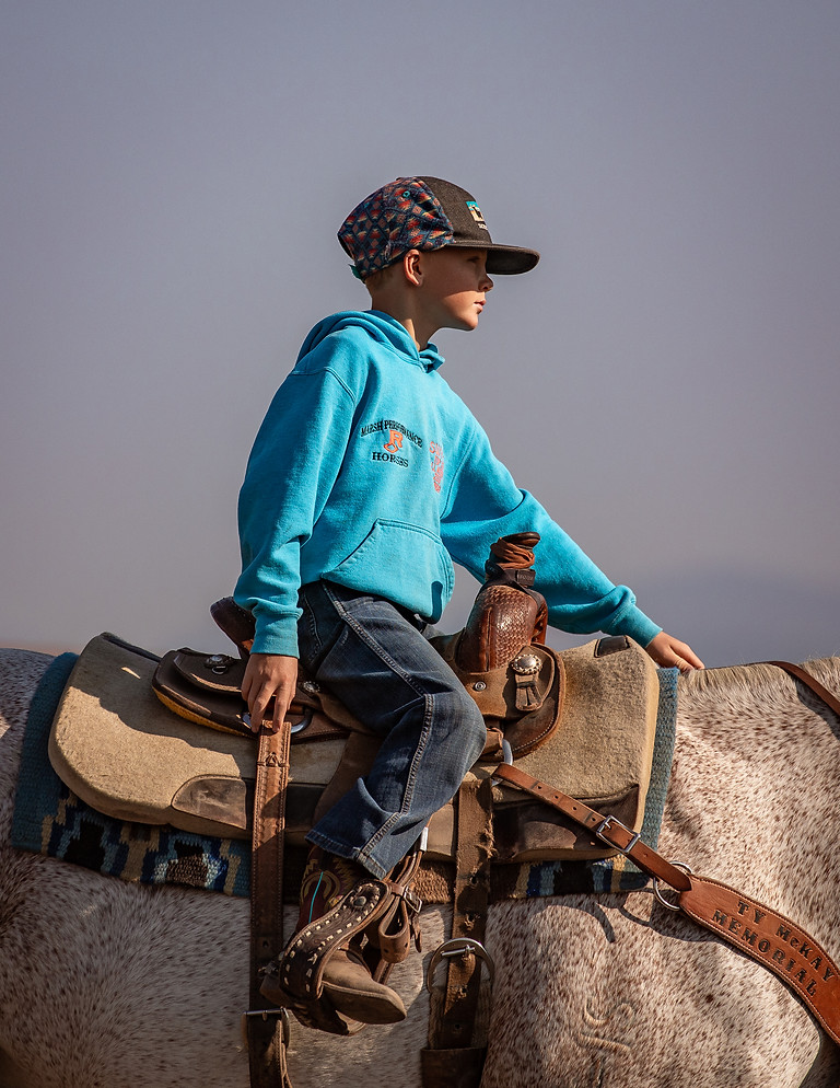 A young barrel racer waits for a turn in the warm-up arena at a peewee competition put on by Marsh Performance Horses in Missoula on Aug. 29, 2020.