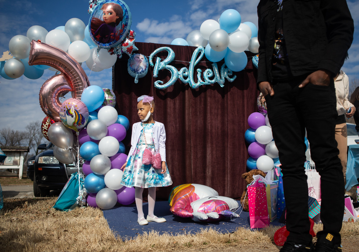 Paydenn Shelton stands among her birthday decorations with her father, Cody Mason, right, before her birthday parade at January-Wabash Park in Ferguson on March 6, 2021.