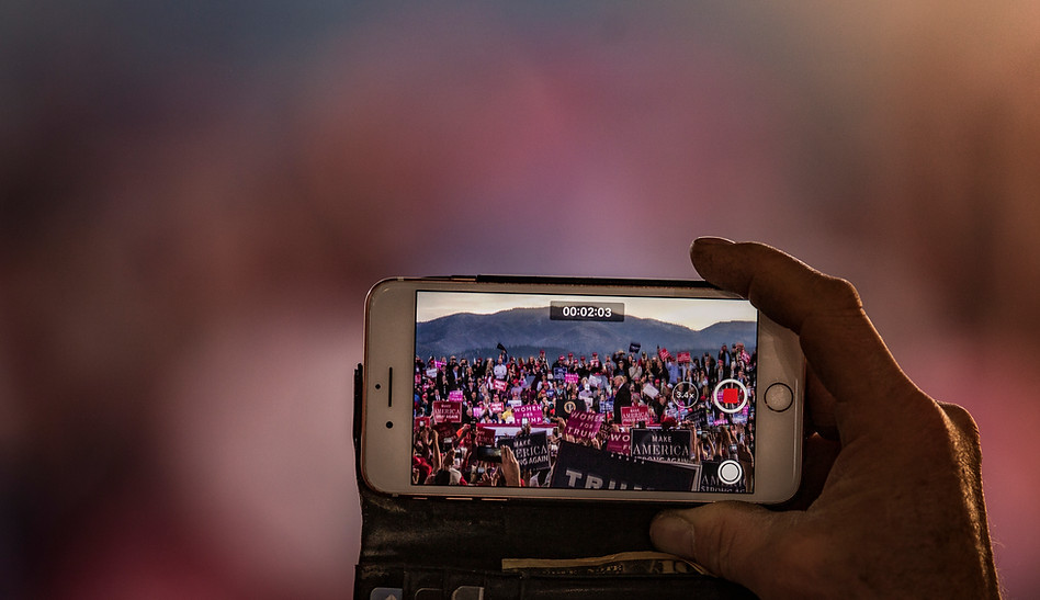 A rally attendee records Trump's stroll to the podium.