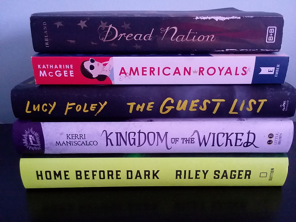 """Stack of the following books: """"Dread Nation,"""" """"American Royals,"""" """"The Guest List,"""" """"Kingdom of the Wicked,"""" and """"Home Before Dark."""""""