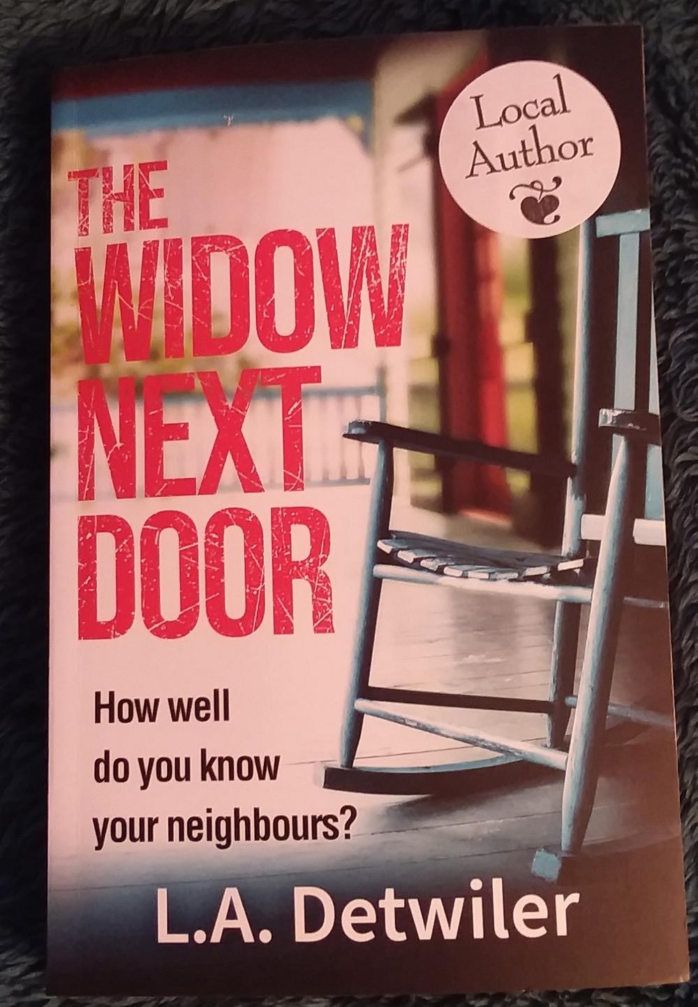 The cover of The Widow Next Door by LA Detwiler