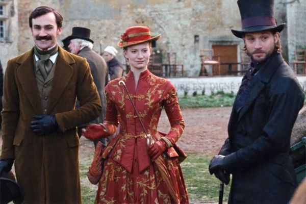 From left to right: Henry Lloyd-Hughes as Charles Bovary, Mia Wasikowska as Emma Bovary, and Logan marshal-Green as Marquis d'Andervilers.
