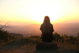 Empowerment Coaching: woman-looking-at-sunset.jpg