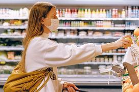 woman-wearing-mask-in-supermarket-396228