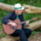 IMG_6001 Phil and guitar on log A.jpg