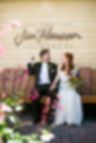 Bride & Groom with Henson sign.jpg