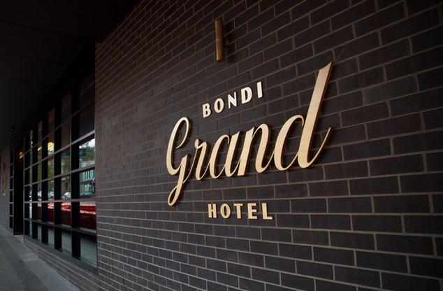 Grand Hotel brass logo.jpg