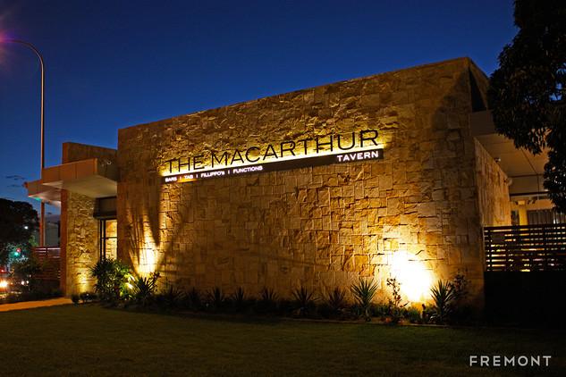 The Macarthur illuminated building sign.