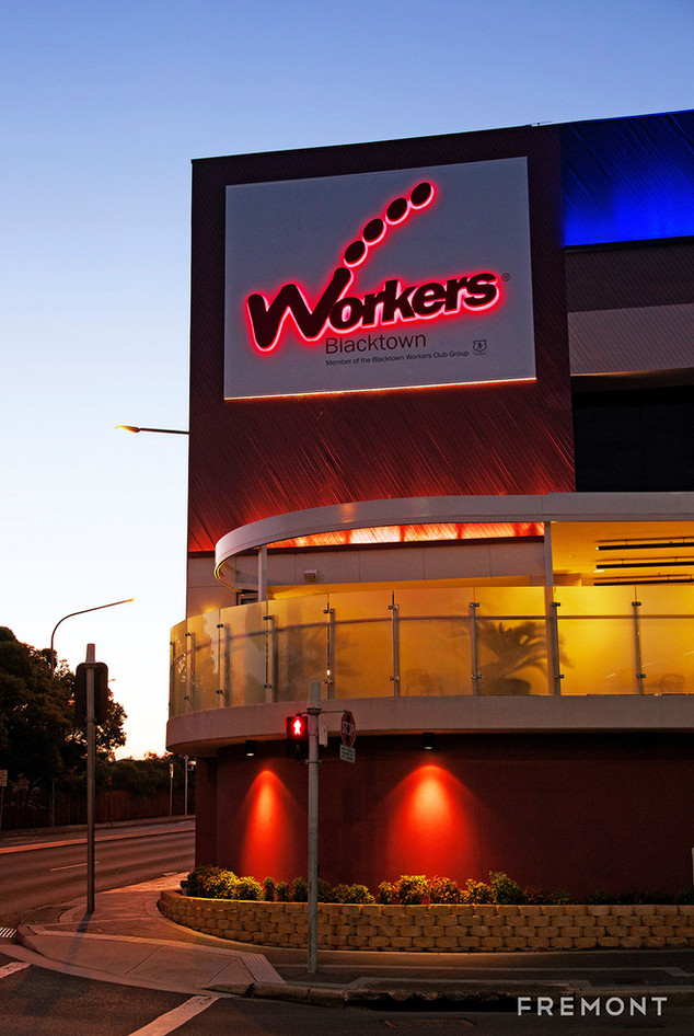 workers illuminated building sign..jpg