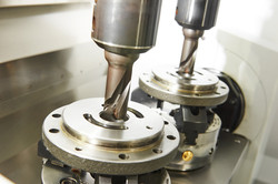 Metalwork industry. Twin milling machine tool with two mills in spindel ready to process metal detai