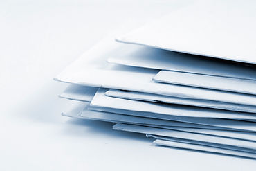 A stack of white envelopes on a white background.