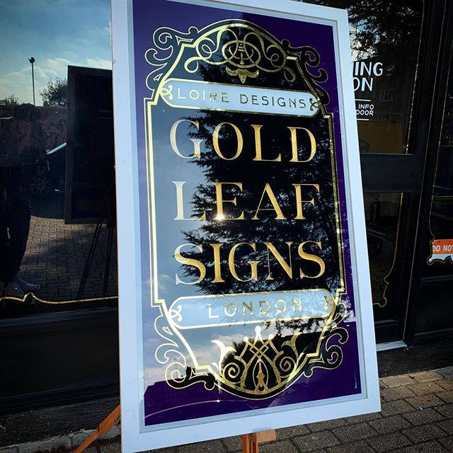 Victorian style glass panel reverse gilded with carved gilded letters. 22ct & 24 ct gold leaf