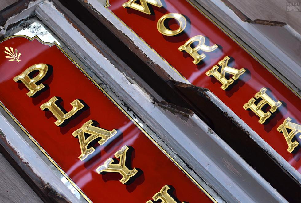 carved gold letters.jpg