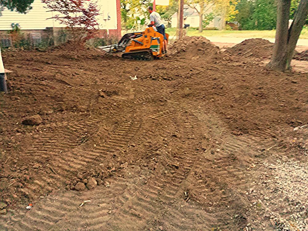 grading, yard leveling, trenching, downspouts burial, downspout trenching, yard grading, regrading yard, soil leveling,  Indianapolis, Carmel, Greenwood, Avon, Speedway, Meridian-Kessler, Geist, Fishers, Zionsville,  Castleton,
