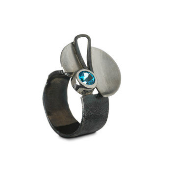 Silver ring with blue gem.