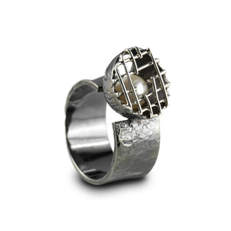 Silver ring with pearl.