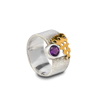Silver ring with purple stone.