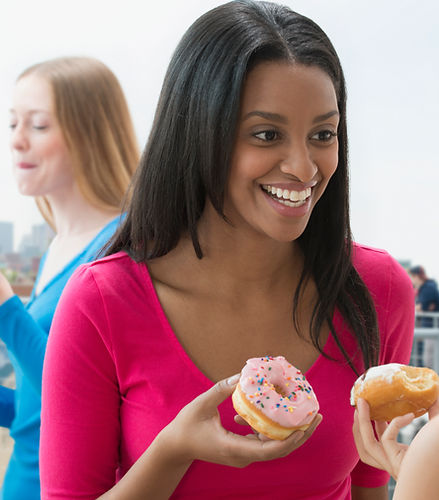 Women Eating Donut
