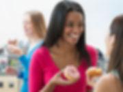 Women Eating Donut