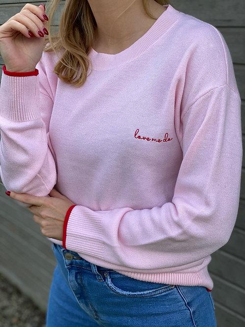 Roze sweater met rood detail