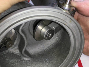 How do you make a waste-gate adjustment on a turbocharger?