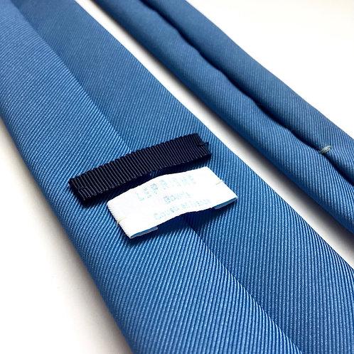 Cravate bleu grisée