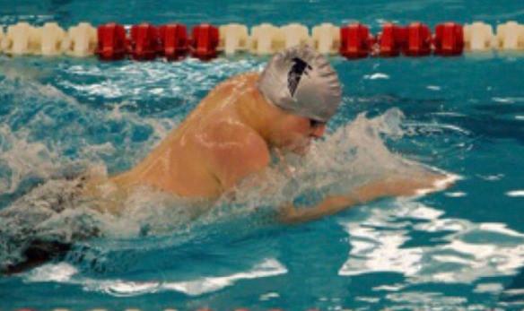 Freshman swimmer breaks league record