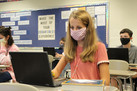 Wearing masks, students return on every-other-day schedule