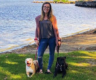 Sabrina walking her two rescue pitbulls
