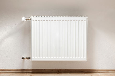 Heating radiator in a white room with la