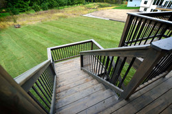 Rear Covered Deck Stair and Backyard