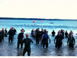 Unbelievable Prices on the Best Open Water Triathlons in DFW and Killer SWAG?