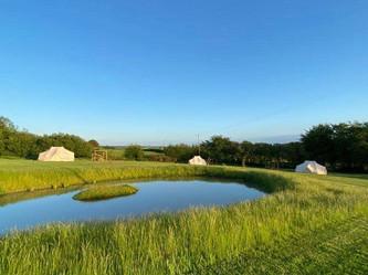Emperor tents overlooking the pond
