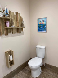 Beach themed shower room with disabled facilities