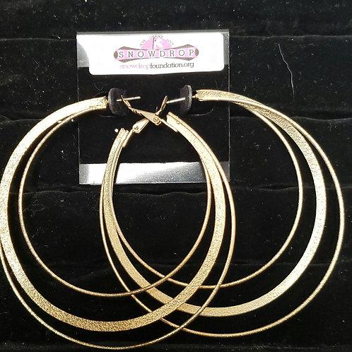 Large gold hoop earrings