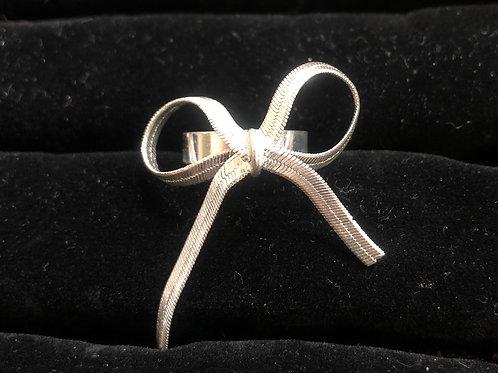 Dangel silver bow ring  size 6 1/2
