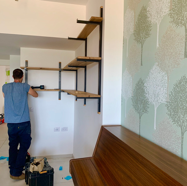 Book shelf being fitted to hang over the