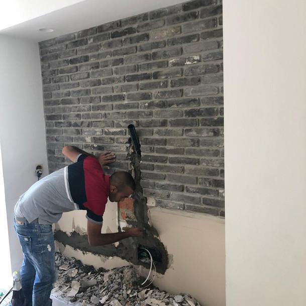 Adding more bricks.