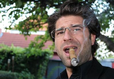 smoking a Nicaraguan cigar