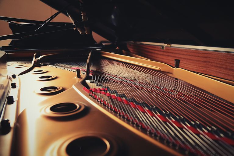 close-up-of-piano-strings-592035391-59d7e6686f53ba0010a5e5b1