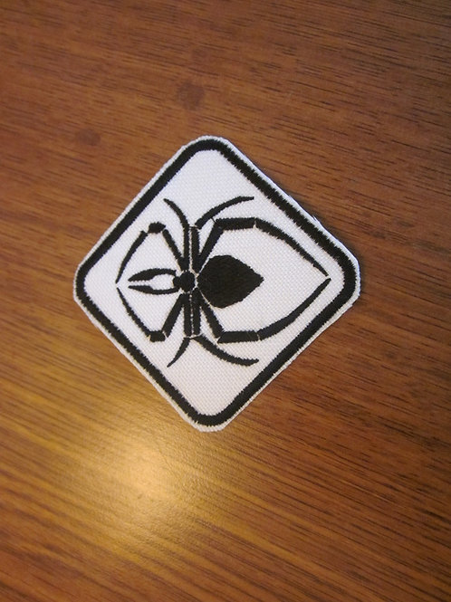 "black spider on white patch  2 X 2"""