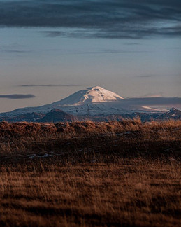 Peak . . .  A sunny mountain peak from t