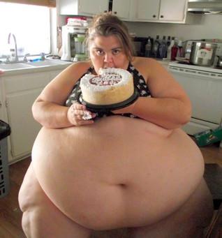 big ass bitch with cake.jpg