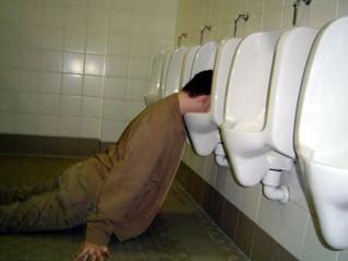 drunk_man_in_urinal.jpg