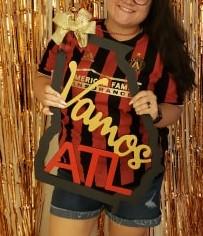 girl holding vamos atl cropped