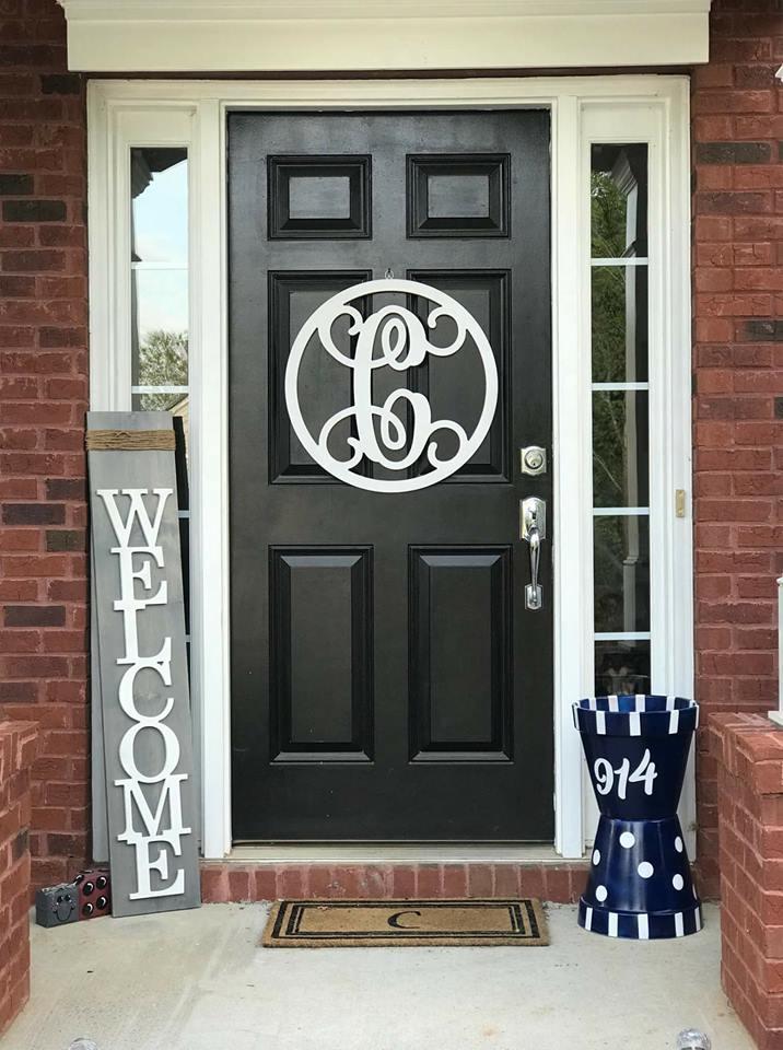 front door with hanger and welcome