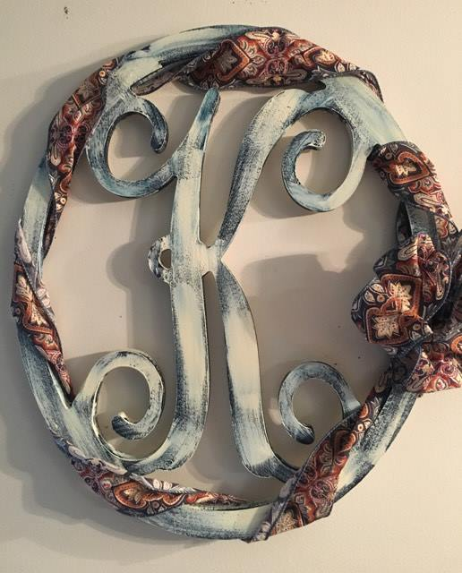 distressed oval K with wrapped ribbon