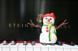 Snowman on piano