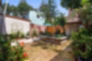 1108-1110 Henriette Delille Courtyard, bistro table